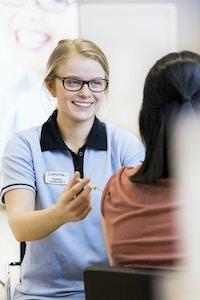 Female doctor vaccinates patient
